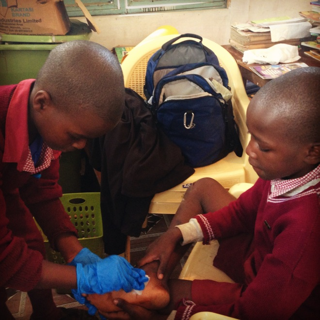 And one of my favorite moments of the week. Walking into my office (which doubles as the medical clinic) and watching one student take care of a bad cut on another student's foot. I think this kid is going to be a daktari.