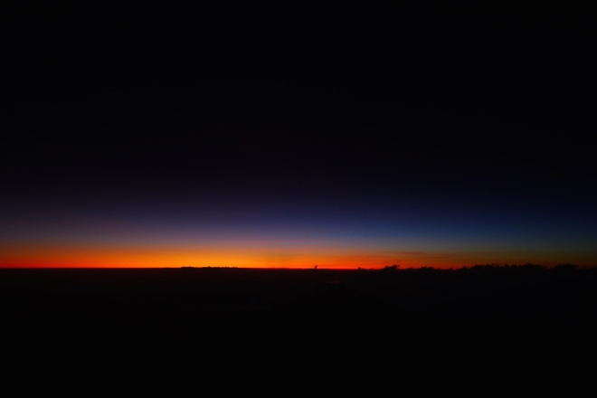 Just past Stella Point, we left to our left and saw the orange tint of the sun coming up...