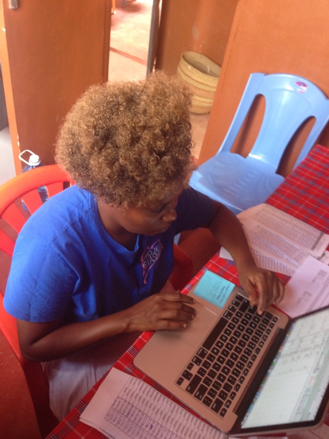 Scola took a computer class last summer paid for by Project Biashara and learned Excel. Here she is working on April payroll.